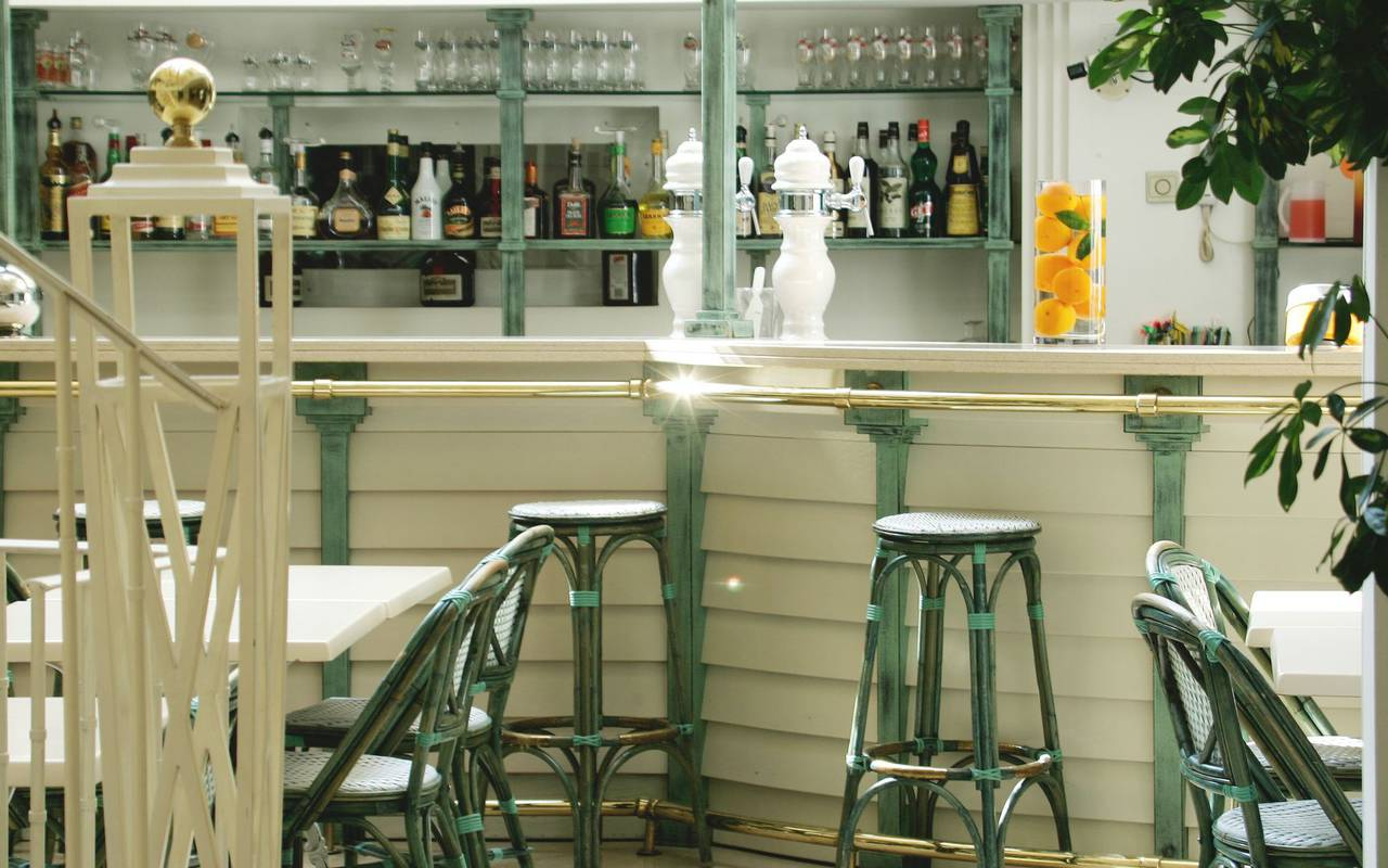 High chairs around the bar with cold drinks, restaurants in lourdes france, Hotel Saint-Sauveur.