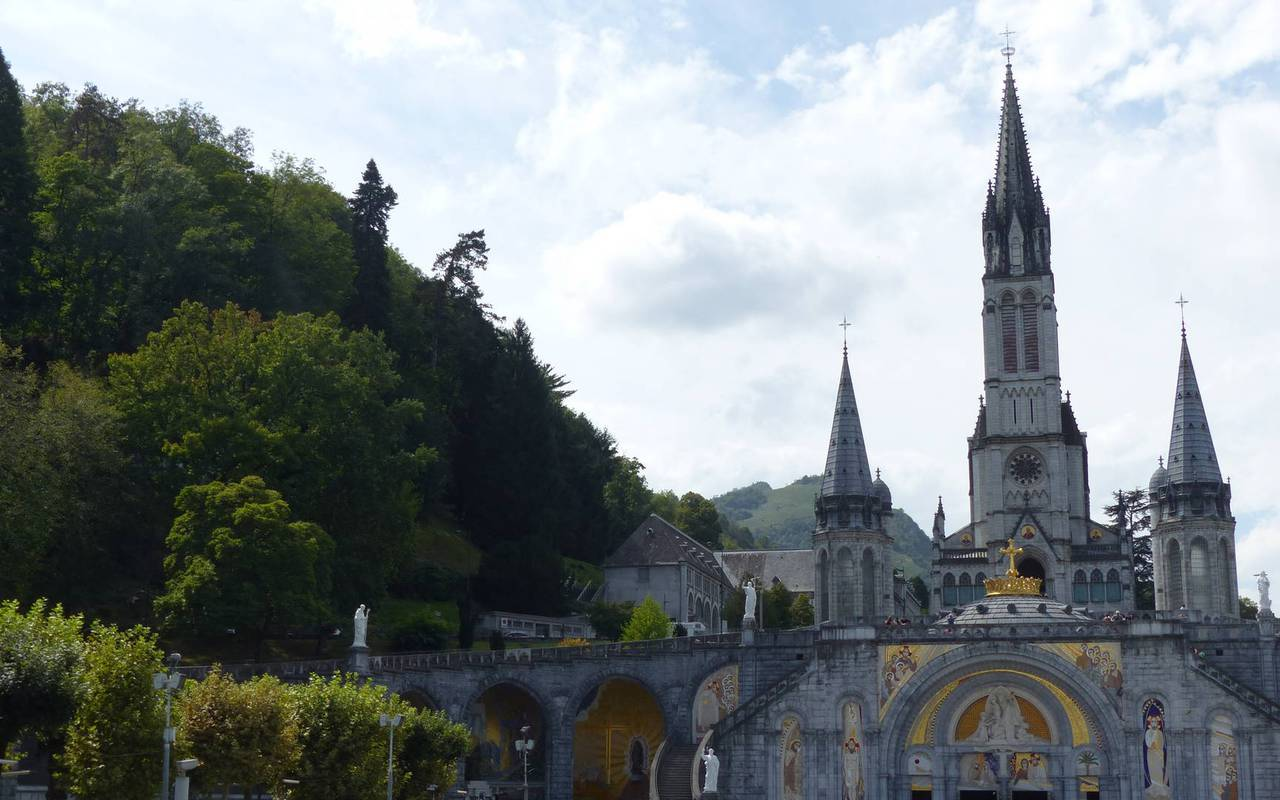 Beautiful Sanctuary of Lourdes seen from the outside, hotel pyreneesn Hotel Saint-Sauveur.