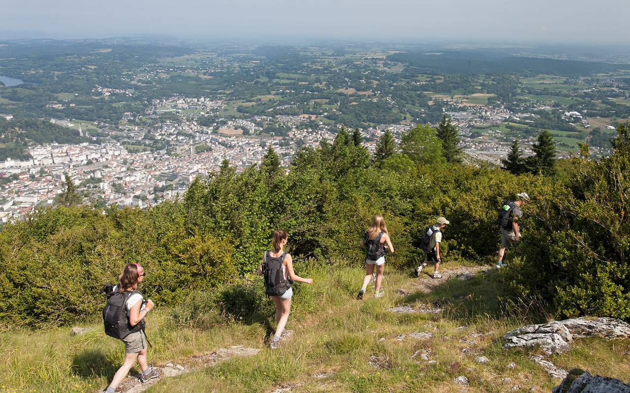 Group hike in the nature with a view on the city, Group hike in the nature with a view on the city,